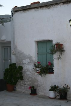 Greece Mykonos ~ Rented room out back behind the Hotel... One dinky window, but... facing the Aegian Sea.  (Had to go down alley around to front up into hotel to use facilities & shower.  In December I almost froze to death on walks back to room w/wet hair.) It cost me something like $110/week. (1972) (akr) http://onira.tumblr.com/post/22115055387/28-avril