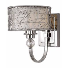The Brandon one-light wall sconce has a nickel plated metal finish that is sure to complement your home's interior decor. To complete this magnificent lighting fixture, this wall sconce features a silver champagne fabric liner.