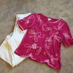 Beautiful Embroidered Top This bright pink top is accented with variations of white and pink thread in a floral, swirl design. Top has a scalloped bottom edge. Size L. Check out the pink open cardigan also available in my closet...they coordinate beautifully! Christopher & Banks Tops Tees - Short Sleeve