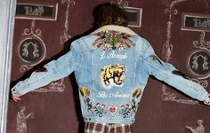 """Stitchwork: Jeans and skirts emblazoned with butterflies, flowers and snakes. Jackets brandishing snarling tigers and the words """"L'Aveugle Par Amour"""" (blind for love). The inspiration for pre-fall's patched denim comes from a whim of Alessandro Michele. Wanting a patched denim jacket on a trip to LA, he hand-stitched one with patches before his flight, creating the prototype for the new collection."""