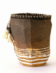 Brenda Holzke~ Inlaid porcelain stoneware basket with stitched fabric and tassels