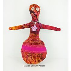 This fun mixed media art doll is blessed with spiritual intent to bring strength, confidence, creativity and more to your life.