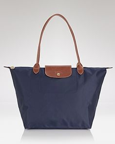 Longchamp Le Pliage Large Nylon Shoulder Tote With a nod to timeless French style, Longchamp's spacious nylon tote perfects the carryall. Its packable design is primed for your daily commute or overseas adventures. Fashion Handbags, Tote Handbags, Fashion Bags, Tote Bags, Replica Handbags, Luxury Handbags, Fashion Ideas, Fashion Inspiration, Shopping