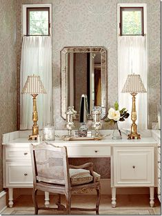 Dressing tables and washstands take stress off of bathroom congestion and can be a lovely accent for a bathroom or bedroom.    This version is perfectly scaled, mixes squat with tall, and is a clever way to make use of two skinny and potentially awkward windows.     Interesting Cote De Texas post about timeless design with antiques or reproductions.