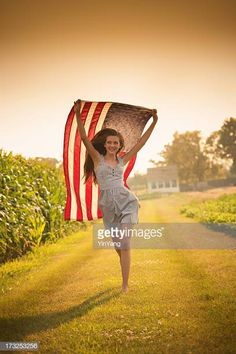 View top-quality stock photos of Patriotic Teen Farm Girl Running Through Field Waving Us Flag. Find premium, high-resolution stock photography at Getty Images. Running Photos, Girl Running, Photo Tips, Country Girls, Royalty Free Images, Flag, Teen, Poses, America