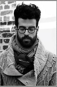 I wish this was in color but I love everything about this picture, hair, beard, sweater and scarf...
