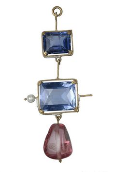Three drop pendant in gold frame. Gold pendant set with two fancy-cut sapphires and an irregular polished spinel. Part of the Cheapside Hoard.     Date  1501 AD - 1625 AD