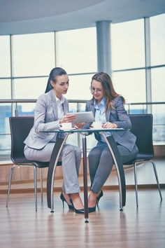 Smart businesswomen working with a tablet Free Photo