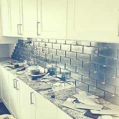 What do you think of this glass backsplash that Amie designed? #FlippingVegas #ScottYancey