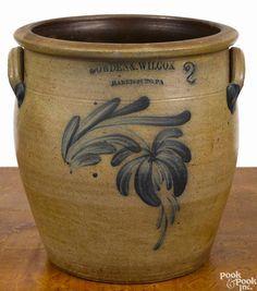 Winning bid:$300 Pennsylvania two-gallon stoneware crock, 19th c., impressed Cowden & Wilcox Harrisburg Pa, with cobalt floral decoration, 9 3/4'' h. - Price Estimate: $200 - $300