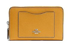 33d0321c501d Coach Crossgrain Leather Accordion Zip Wallet F54007 SV Mustard at Amazon  Women s Clothing store