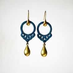 LOVE this mix of delicate shape with the mix of crochet and metal. Blue Crocheted Hoop with Large Brass Drops