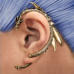 """- Through Your Ear Dragon Earring in gold and silver - Lightweight and won't hurt your ear - Requires pierced ear to be worn - Premium metal tin packaging - Made of metal alloy - Dimensions: 1.97"""" x 2"""