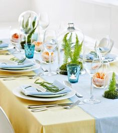 Keep your spring gathering light and airy with linen table coverings and clear glass containers. Details + more spring centerpieces: http://www.midwestliving.com/homes/seasonal-decorating/50-bright-and-easy-spring-decorating-ideas/?page=29