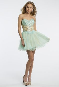 Camille La Vie short party dress with a strapless sweetheart beaded neckline, a scattered beaded lace corset bodice and a two-toned mesh a-line skirt whose zipper is located at the center back of the dress. • Beaded neckline• Corset Bodice • Two-toned mesh• Center back zipper placement