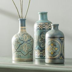 Cluster this trio of charming vintaged bottles on the kitchen island filled with fresh-picked blooms for an elegant centerpiece, or set them side by side on the foyer console table to tie together your antiqued entryway ensemble. Wine Bottle Art, Diy Bottle, Bottle Vase, Bottles And Jars, Bottle Crafts, Glass Bottles, Liquor Bottles, Traditional Vases, Glass Theme