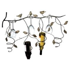 Showcase your favorite vintages in the dining room or parlor with this whimsical wall-mount wine rack, showcasing a lovely vine and bird silhouette. Holds 4 ...