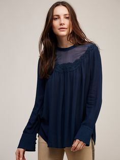 Mix it up Blouse | In an oversized silhouette this sheer long sleeve blouse features a mock neck with sheer detailing along the neckline and a crochet trim. Delicate button detailing on the back neck and cuffs. Rounded hem.