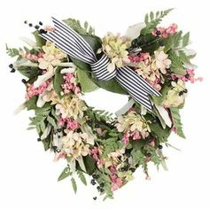 Preserved heart-shaped wreath with pink hydrangea and natural fern.  Product: Preserved  wreathConstruction Material: Silicone, natural twigs and ribbonColor: Multi Dimensions: 10 H x 10 W x 3.5 D Cleaning and Care: Wipe gently with a dry cloth