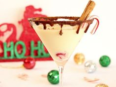 Italian Egg Nog  1 oz Disaronno  1 oz vodka  2 oz eggnog  Cherry  Cinnamon  Brown sugar  Caramel syrup  Candy cane    Mix sugar, caramel and cinnamon.  Rim glass and put in freezer.  Shake eggnog, vodka and disaronno with ice.  Put cherry in bottom, pour in drink, sprinkle with cinnamon, garnish with candy cane or cinnamon stick