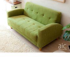 ナチュラルなグリーンのソファー