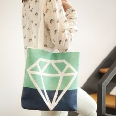 Customize your own tote with a geometric gem design using fabric paint.