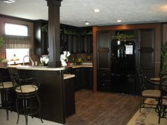 I like the look of the black cabinets with the dark wood. Won't show dirt like white cabinets will. This is key lol