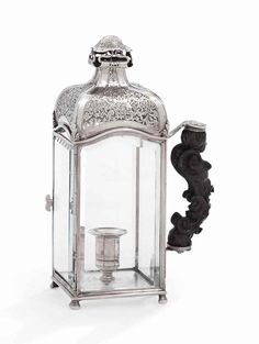 A CONTINENTAL SILVER LANTERN CHAMBER-CANDLESTICK  APPARENTLY UNMARKED, PERHAPS ITALIAN, FIRST HALF 18TH CENTURY