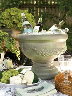 A spray-on aged finish instantly gives this lightweight plastic faux cement urn a sturdy, rustic look, perfect as an ice and beverage bucket for your next outdoor party.