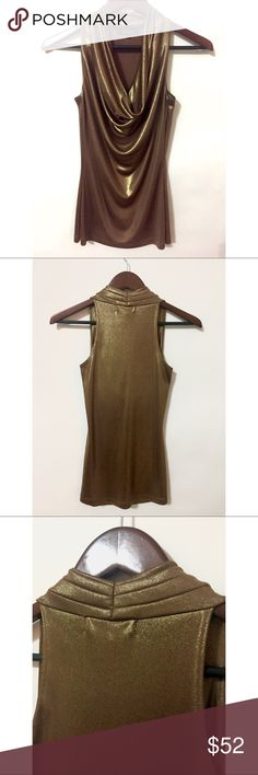 Karen Kane Gold top This Karen Kane piece was worn only once and is a stunner. Looks great with a black high wanted skirt! Its very stretchy and looks like liquid gold!  This one is a show stopper!  Size Small, Perfect Condition Karen Kane Tops