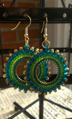 Hey, I found this really awesome Etsy listing at https://www.etsy.com/listing/126298480/green-handmade-beaded-hoop-earrings