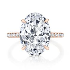 FRANCESCA is a custom solitaire engagement ring set in Rose Gold with a rare D Color, IF Type IIa Clarity Oval cut diamond by designer Jean Dousset.
