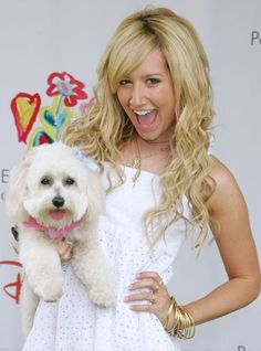 """Actress Ashley Tisdale and her dog Blondie attend """"A Time for Heroes Celebrity Carnival"""" sponsored by Disney to benefit the Elizabeth Glaser Pediatric AIDS Foundation on the grounds of the Wadsworth Theater on June 11, 2006 in Brentwood, California. (Photo by David Livingston/Getty Images)"""
