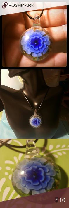 Pretty Glass Murano Flower Necklace This is a pretty glass murano blue flower pendant necklace. Very pretty and unique. In good condition. Multi colors on back. Jewelry Necklaces