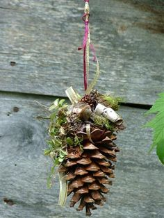 Decorative pine cone with boxwood, birch shavings, sphagnum moss, green sheet moss, ribbon, acorn etc.