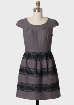 """KRISTEN DRESS BY DARLING UK at shopruche.com. Crafted in a fine wool blend, this elegantly structured charcoal gray dress features luxurious black lace detailing and adorable cap sleeves. Finished with a hidden back zipper closure and subtle gathering at the neckline. Fully lined.    Shell: 50% Wool, 50% Viscose  Lining: 97% Polyester, 3% Spandex  Lace: 100% Polyester  Imported  33.75"""" length from top of shoulder  32"""" bust  28"""" waist  All measurements taken from a size small  $115.99"""