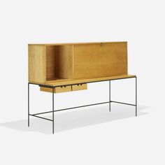 Lot 112: Paul McCobb. Planner Group desk. 1952, maple, enameled steel. 60 w x 22 d x 43¼ h in. result: $3,500. estimate: $2,000–3,000. Desk is composed of two pieces: cabinet, model 1562 and table, model 1596 featuring two drawers. Cabinet features drop-front work surface concealing storage and two drawers.