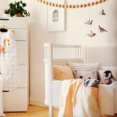 Soft, neutral colors with a touch of whimsy baby/child's room to love!