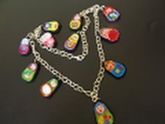 Eco-Chic: Collar de muñequitas (Matrioskas) Con anillas de lata