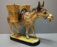 As the humble creatures they are, donkeys are almost always represented in majolica for the utilitarian use they have to mankind. Not very grand but still proud in their simple dignity, donkeys are our beasts of burden. No company has been more conscious of them than the frėres Massier, who have done a number of donkeys in majolica.