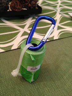 Doggy poop bag holder Run a zip tie thru center tube, trim excess but leave a little to pull on so it remains snug as bags are used.  Clip to a carabiner and attach to lead/leash, collar, belt loop, jacket etc