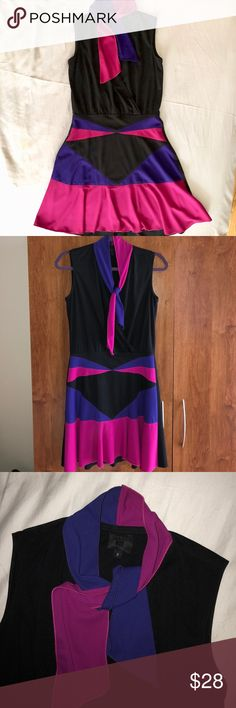 Anna Sui flared dress Pussy Bow tie Sz 2 Flows and drapes so nicely! Worn only twice (because social media). Fun purple and pink contrast colors. Fun dress! I  no longer work in finance and don't have to dress up for work so selling all dress up clothes. Size 2 fits perfectly if you're a small petite frame. True to size. Moving and downsizing closet. Everything must go! Please check out all my other styles too! Anna Sui Dresses Mini