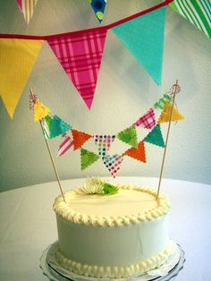 fabric cake bunting on bakers twine..for the princess cake! @Eva Evans .. i think i'll do something like this for a cake instead of cupcakes! :)