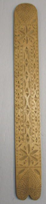 WOODEN BUSK. Chip carved with compass stars and h
