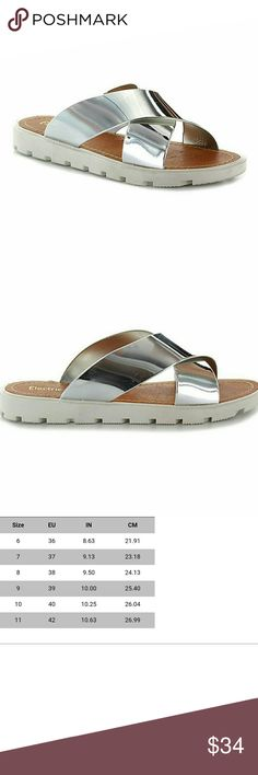 JUST INElectric Karma Silver Sandals From electric karma.  Comfy and nice thickness in the sole.  This slip on sandal will be your go to pair for the summer! Plus, silver goes with so much.  Sustainable materials.  Available in 8, 9 and 10.  See pic 3 for sizing info.  Update: these run small, especially if you have a wider foot.  Very comfy but I had to go up a size. Shoes Sandals