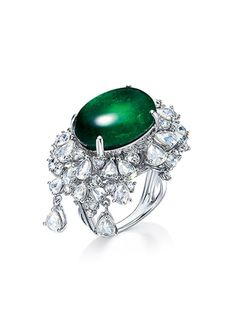 A CARAT EMERALD AND DIAMOND RING. Set with an oval-shaped emerald, weighing approximately carats, within vari-cut diamond surround, accented by a pear-shaped diamond, mounted in gold. Diamond Rings, Diamond Engagement Rings, Diamond Cuts, Gemstone Rings, Emerald Jewelry, Diamond Jewelry, Marcasite Jewelry, Pear Shaped Diamond, Diamond Pendant Necklace