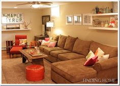 Warm neutrals with red accents would make the basement feel large yet cozy and warm.