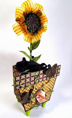 From the gentleman crafter's blog. Sunflower made from Ribbon and brads - made into a ribbon box.