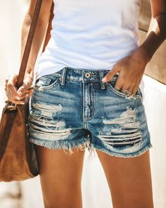 Complete your summer look with a pair of destructed or distressed denim shorts from Rebel Threads Boutique! We know that the right shorts can perfect any outfit, and you'll find nothing but the best in women's summer fashion in our extensive onlin. Distressed Shorts, Ripped Denim, Ripped Shorts, Short Shorts, Denim Jeans, Black Jeans, Jean Short Outfits, Beste Jeans, Estilo Jeans