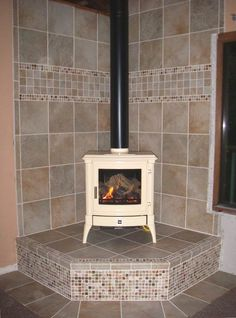 tiled wood stove hearth | In the preview (at least on my laptop), the stove looks so bright it ...